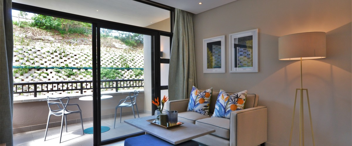 Lounge with large flat-screen TV at 417 Zimbali Suites